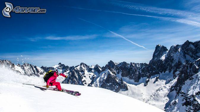 Skifahren, schneebedeckte Berge, felsige Berge
