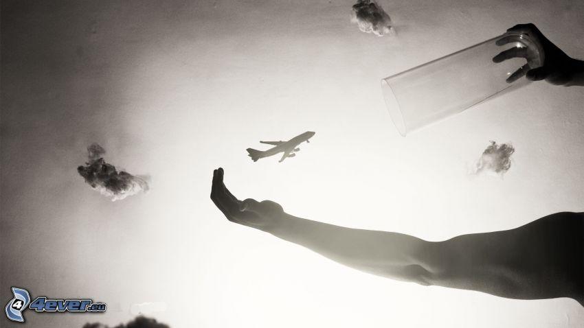 Silhouette des Flugzeuges, Hände, Tasse