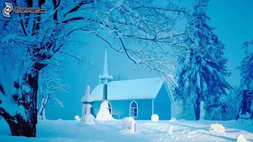 Kirche, Friedhof, verschneite Landschaft