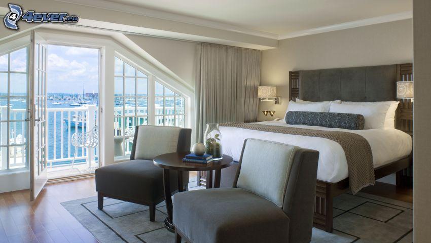 Schlafzimmer, Doppelbett, Armstühle, Blick auf dem Meer