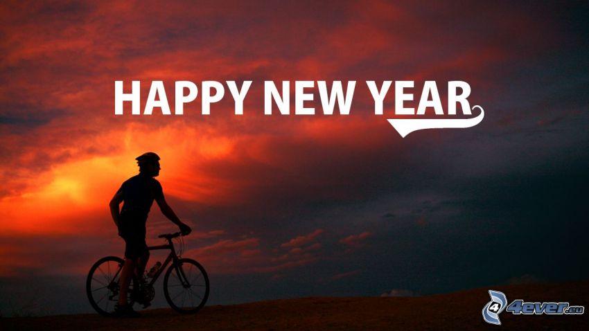 glückliches Neues Jahr, happy new year, Radfahrer, der rote Himmel