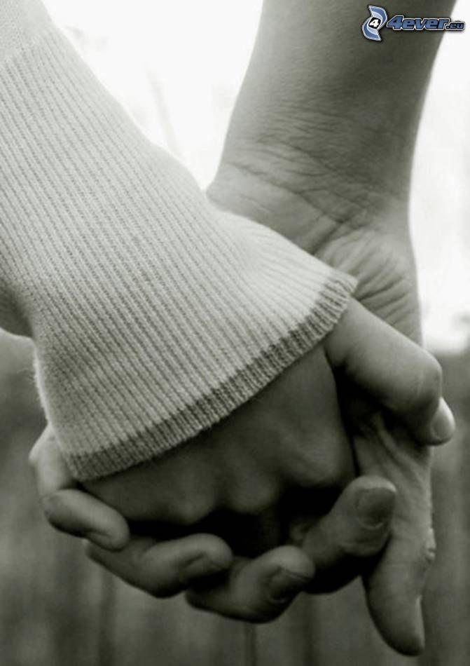 halten sich die Hände, Paar