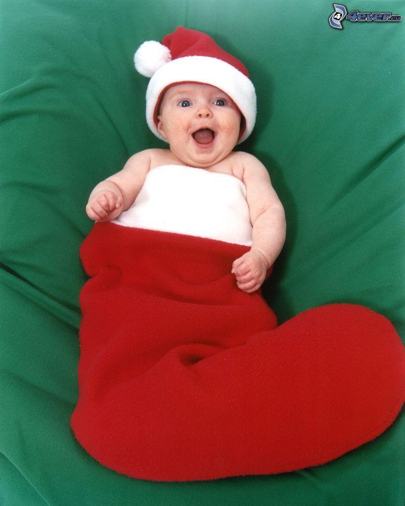 weihnachtliches Baby, Stiefel, Geschenk, Lächeln
