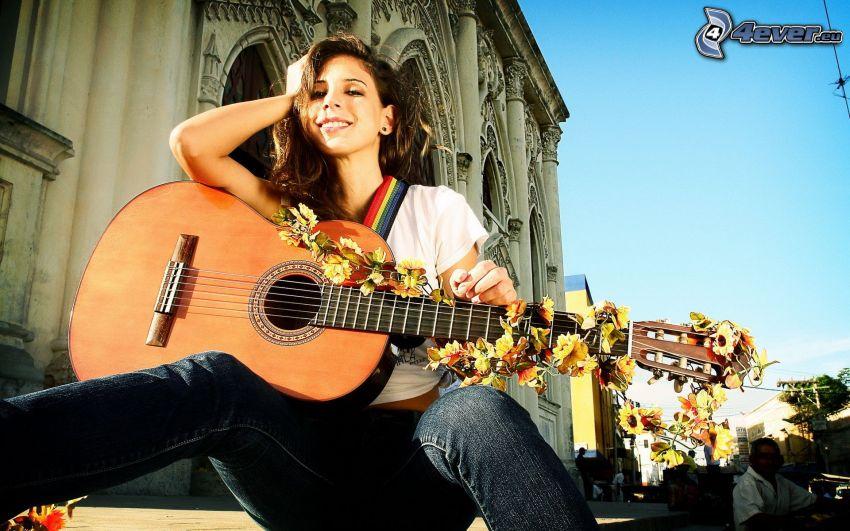 Mädchen mit Gitarre, historisches Gebäude