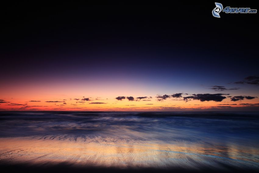 Strand nach dem Sonnenuntergang, Meer, Abendhimmel