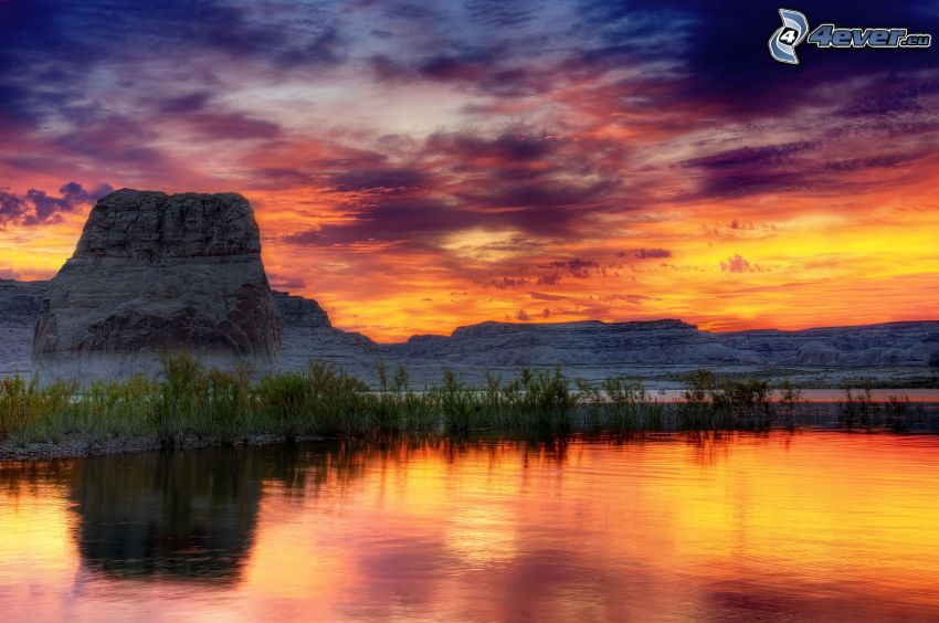 See, orange Sonnenuntergang, Felsen