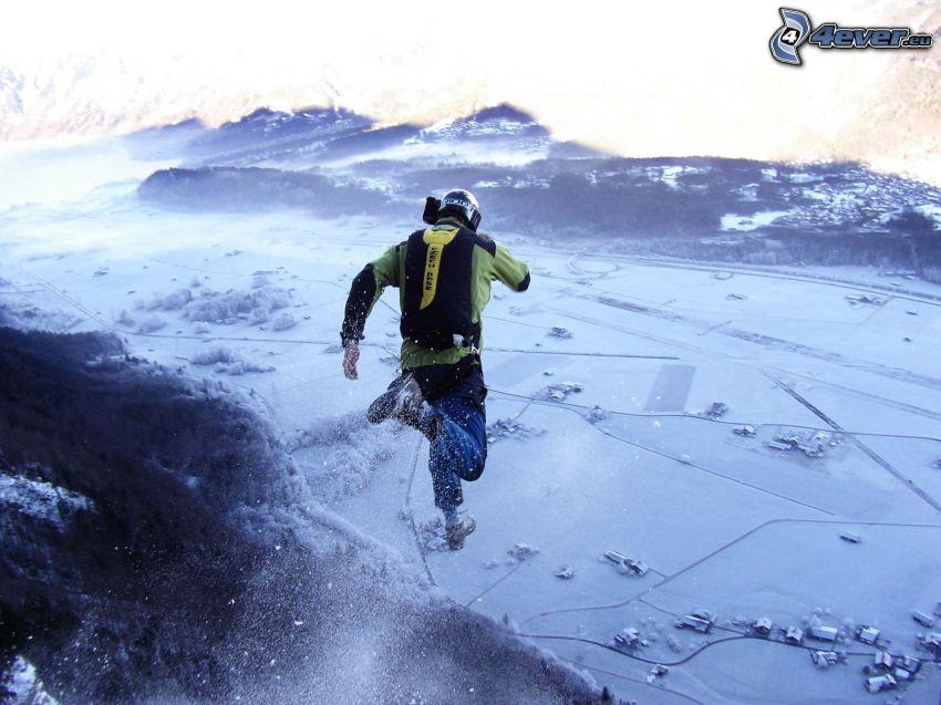 BASE Jump, verschneite Landschaft