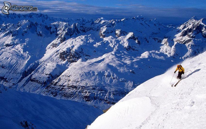 Skifahren, Skifahrer, schneebedeckte Berge