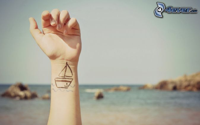 hand, tatuering, öppet hav
