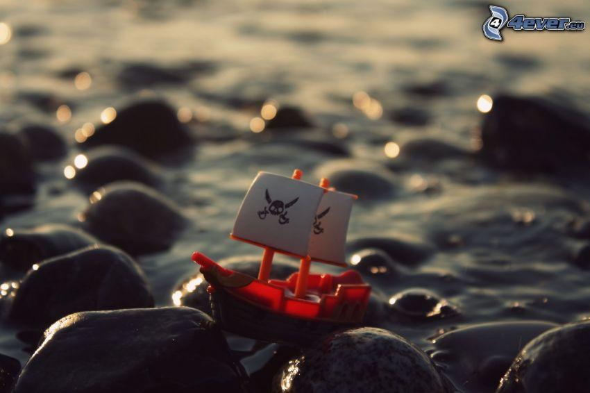 båt på havet, stenar