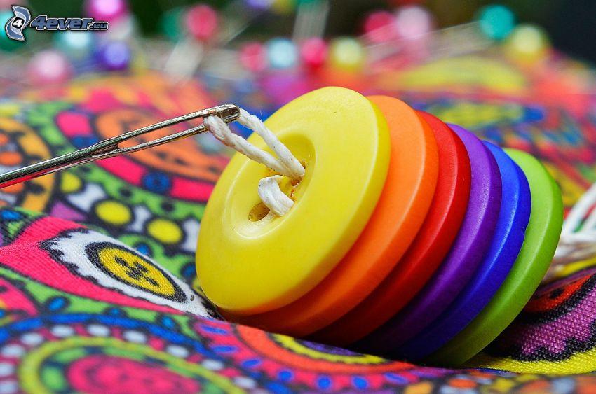 knappar, färger, nål och tråd