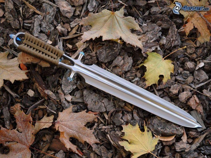 kniv, nedfallna löv