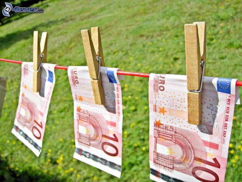 sedlar, pengar, tråd, klädnypor på tråd