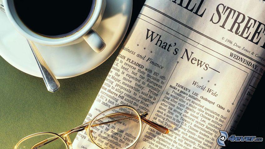 tidning, glasögon, kaffekopp