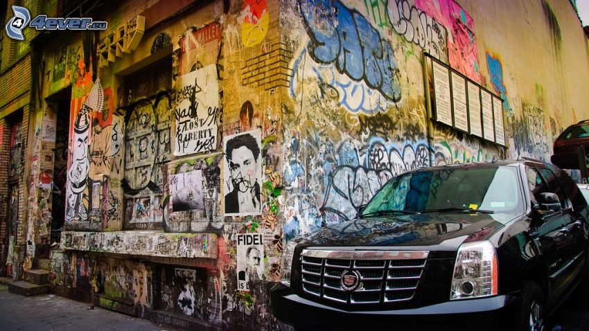 Cadillac, gammal byggnad, graffiti