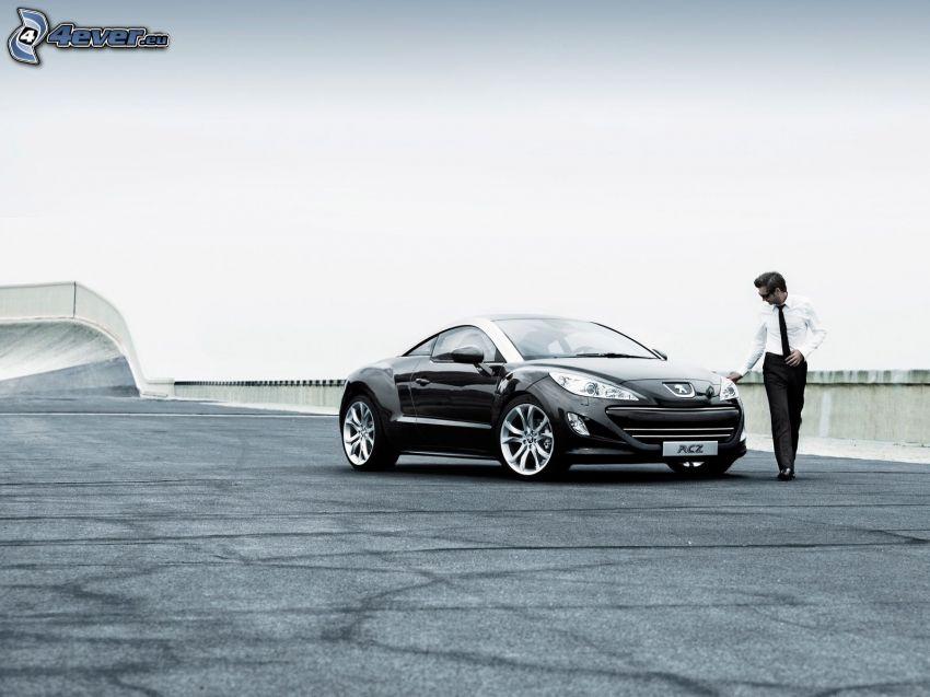 Peugeot RCZ, man i kostym