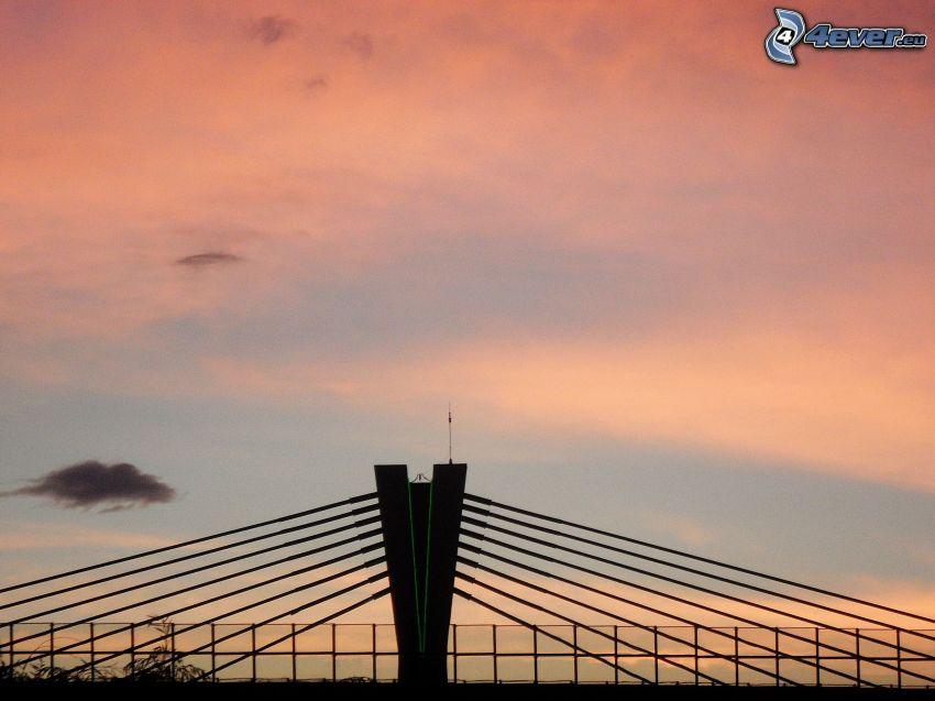 motorvägsbro, röd himmel