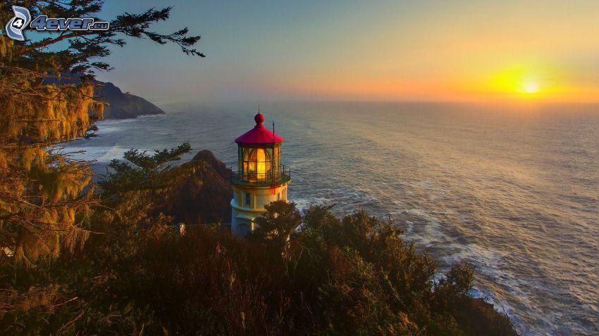 fyr vid solnedgång, havsutsikt