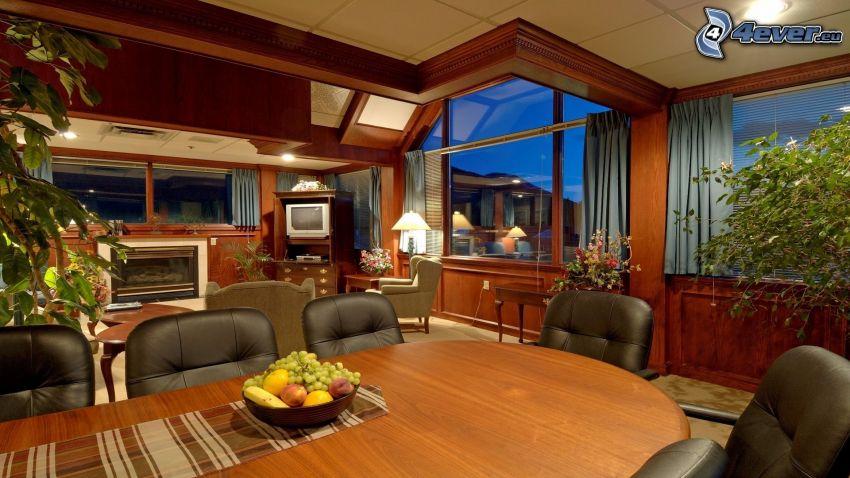 lyxigt vardagsrum, bord, fåtölj