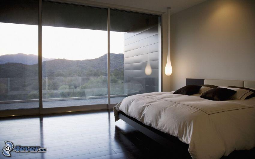 sovrum, dubbelsäng, fönster, utsikt över landskap