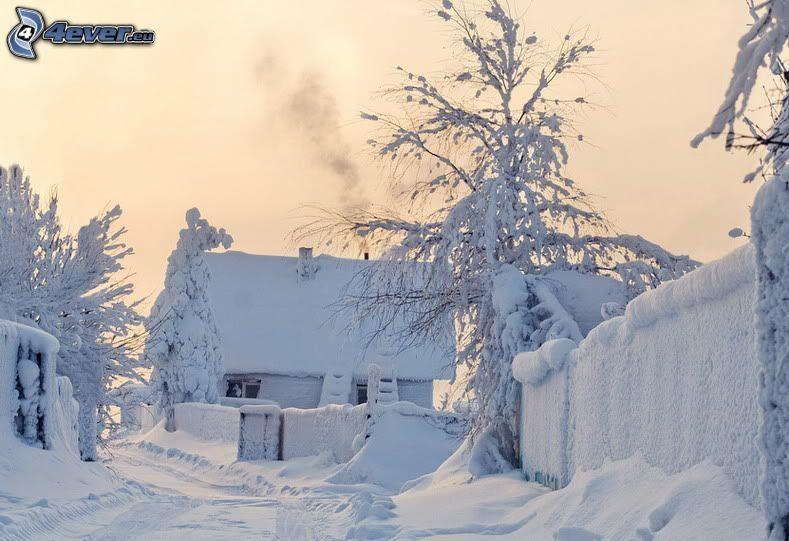 översnöat hus