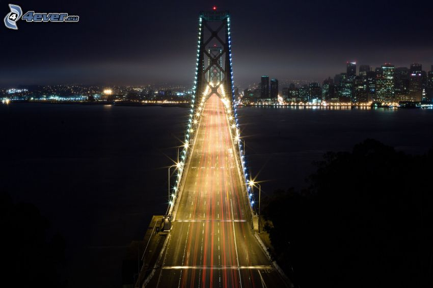 Bay Bridge, San Francisco, nattstad, upplyst bro