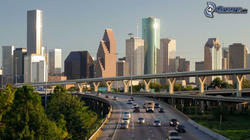 Houston, skyskrapor, motorväg, träd