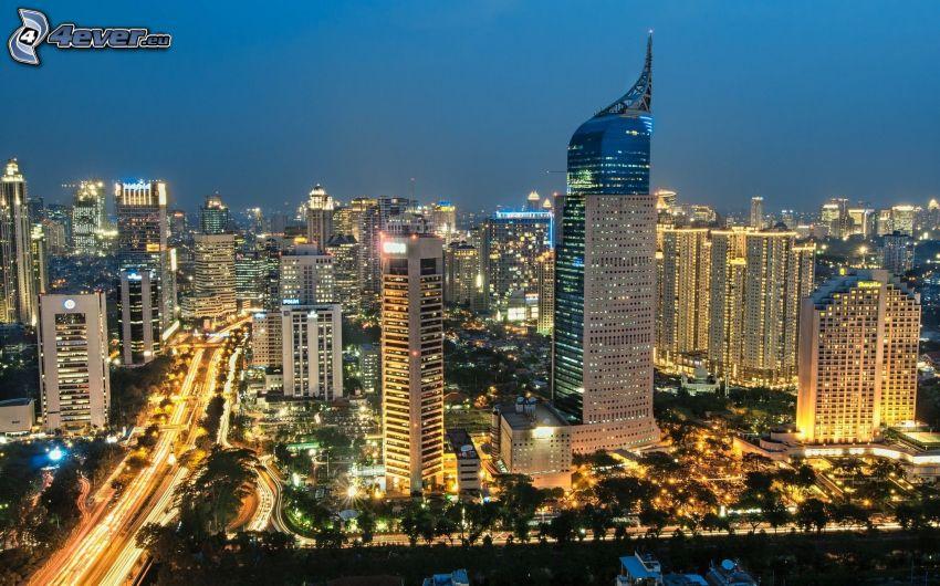 Jakarta, kvällsstad, skyskrapor