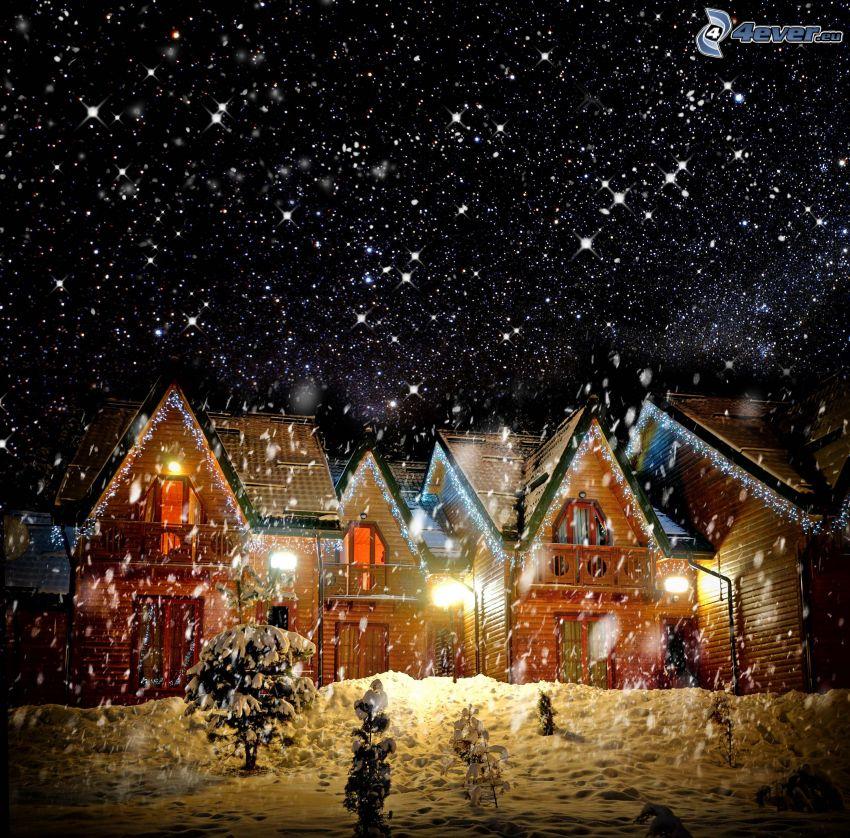 snöig by, stugor, snöfall, natt