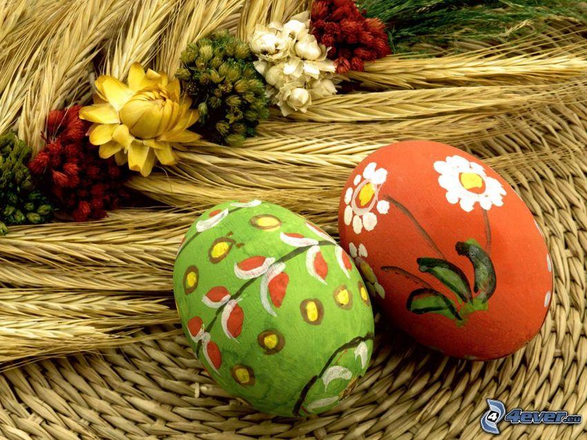 målade ägg, påskägg, säd, fältblommor