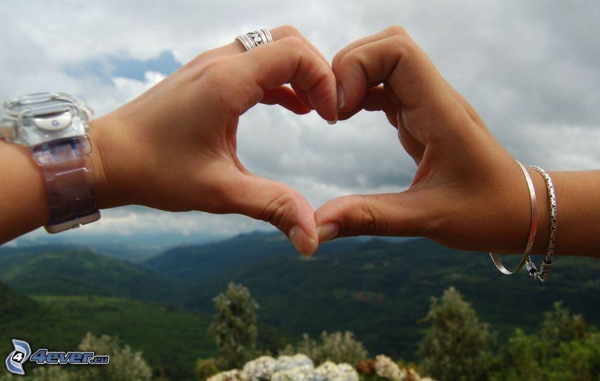 hjärta av händer, utsikt över landskap, klocka, armband