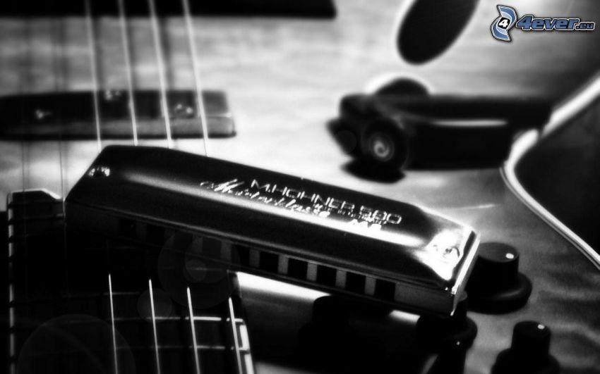 munspel, gitarr, strängar, svartvitt foto