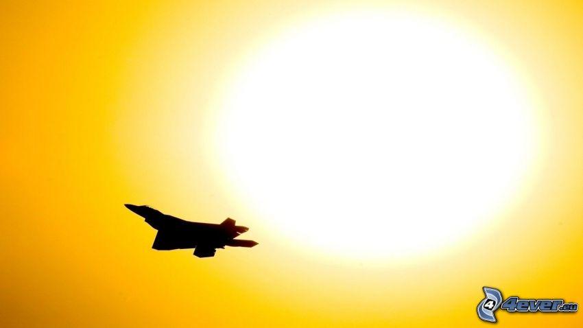 F-22 Raptor, silhuett av jetplan, sol