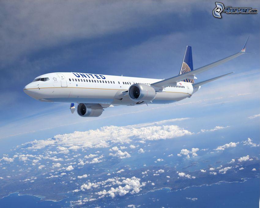 Boeing 737, ovanför molnen, hav