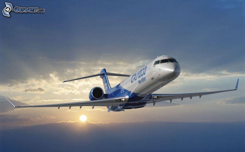 Bombardier CRJ 1000, solnedgång över molnen