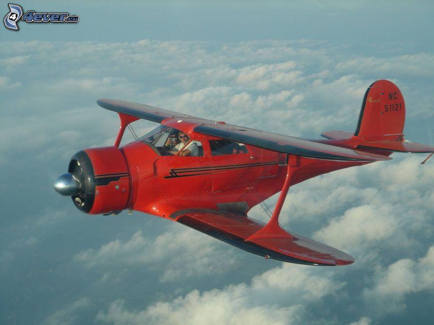 dubbelvingat flygplan, ovanför molnen