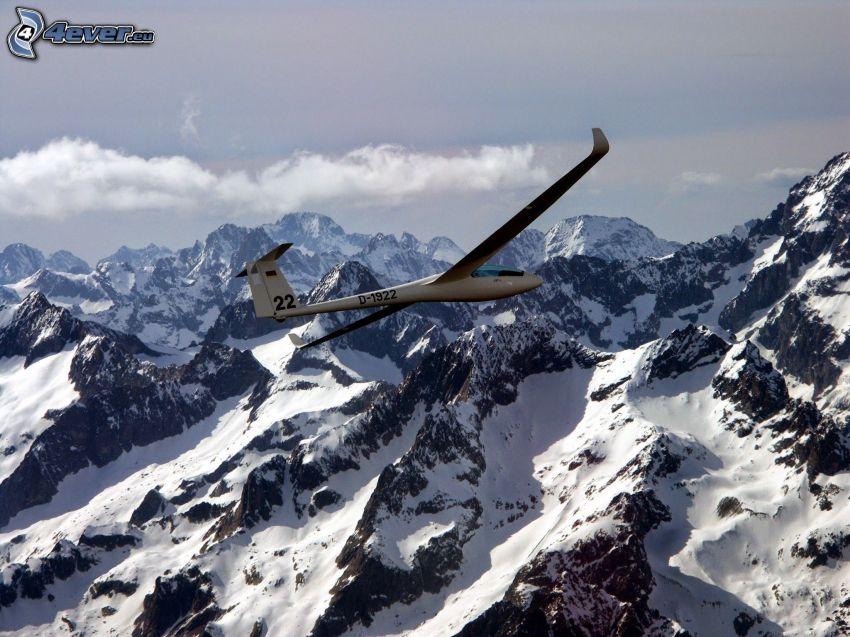 segelflygplan, snöklädda berg
