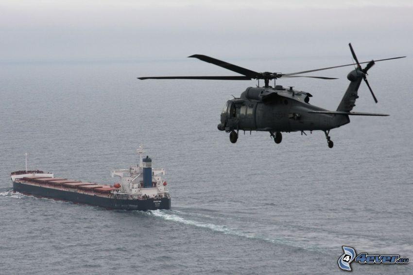 militär helikopter, fraktfartyg, hav