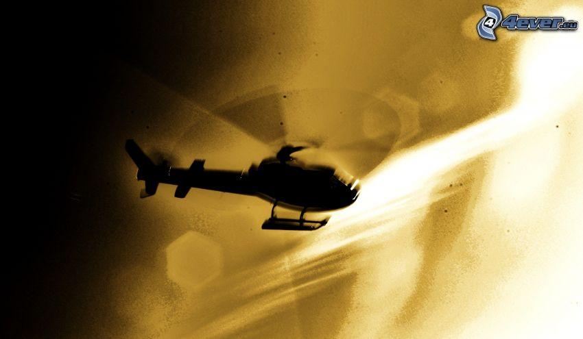 silhuett av helikopter