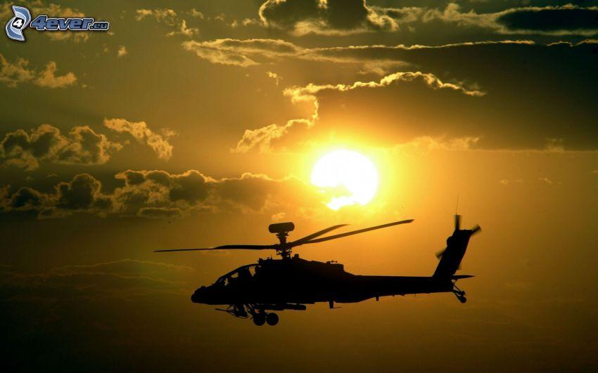 silhuett av helikopter, sol, moln