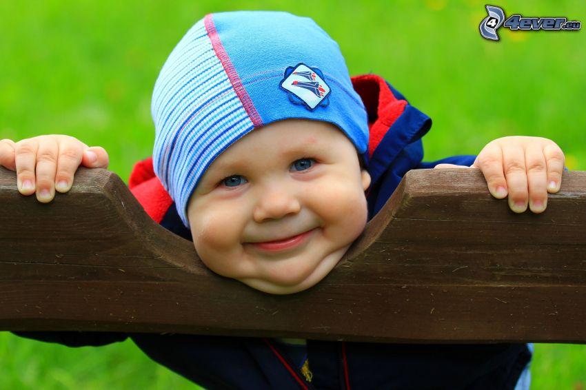 liten pojke, leende
