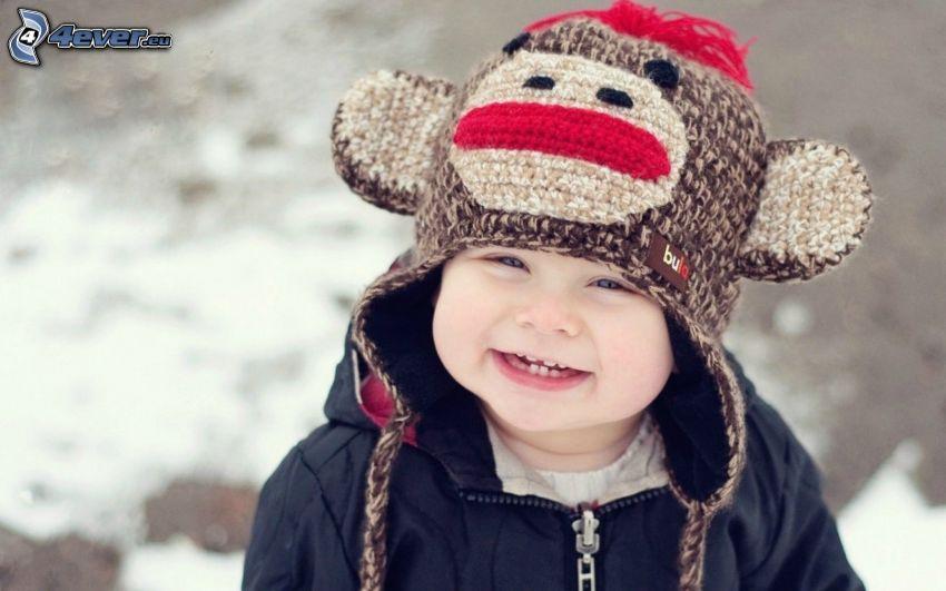 liten pojke, mössa, leende