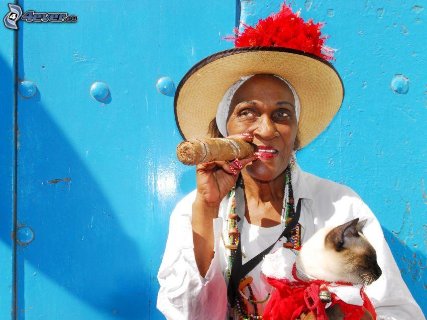 mörkhyad kvinna, siameskatt, cigarr
