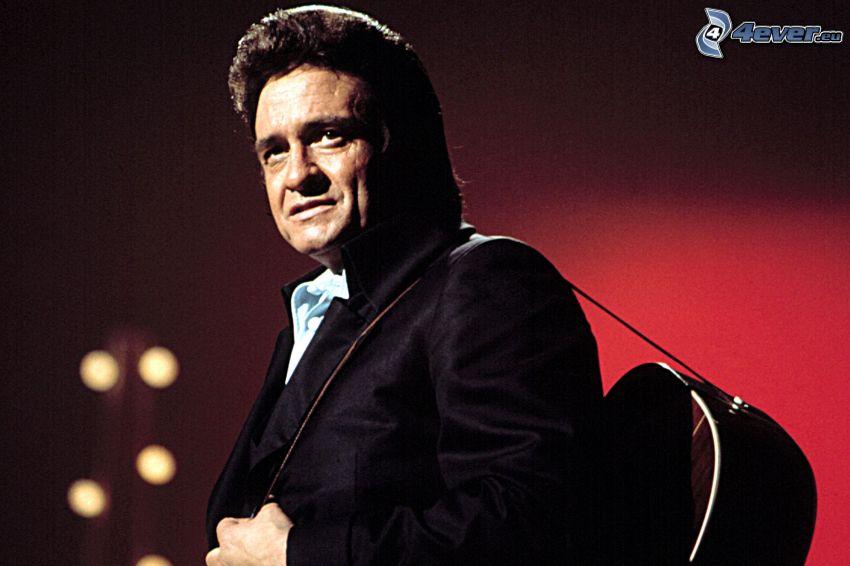 Johnny Cash, man med gitarr, gammalt foto