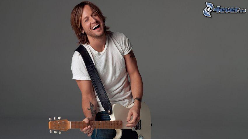 Keith Urban, man med gitarr, skratt