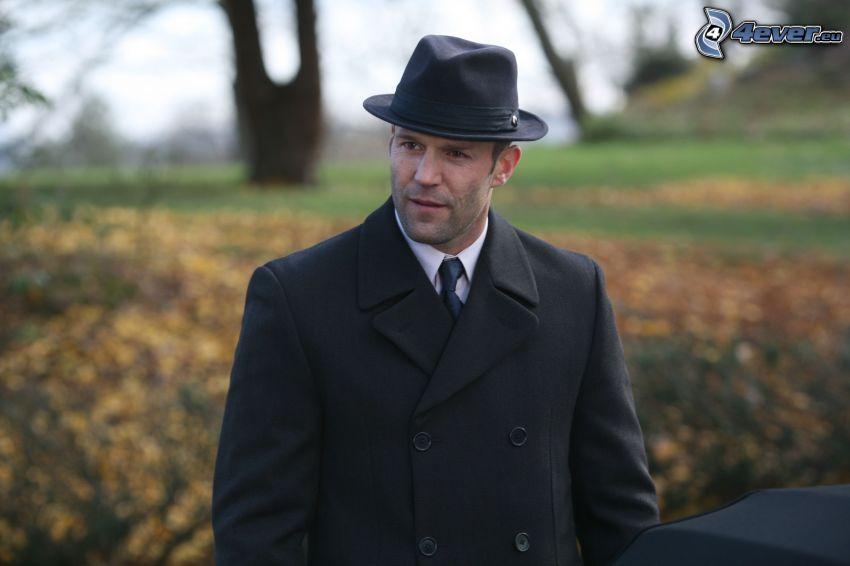 Jason Statham, man i kostym