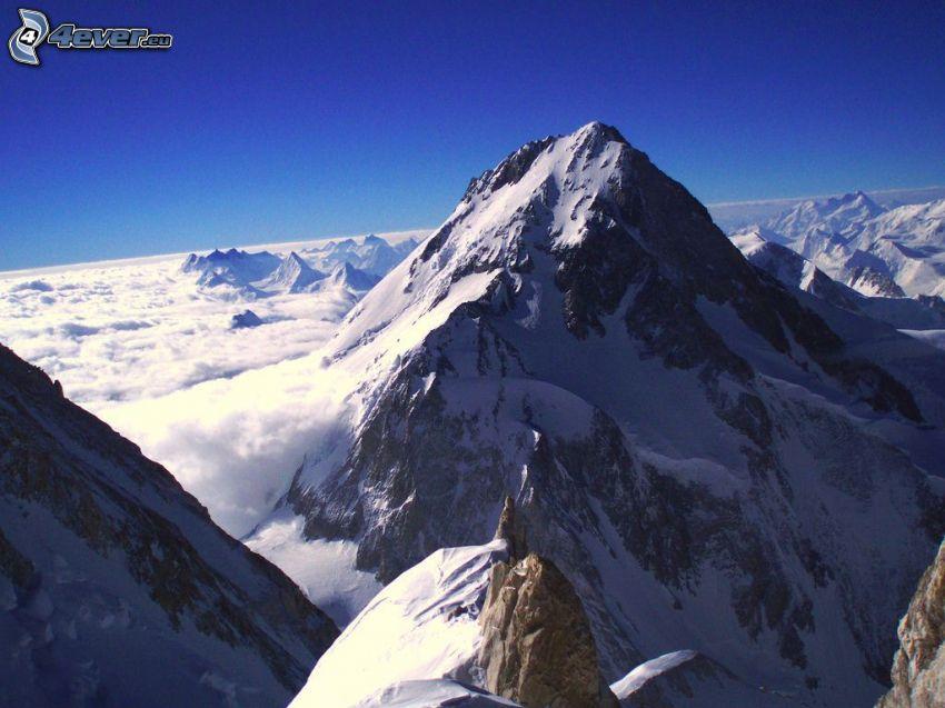 Cho Oyu, snöklädda berg, ovanför molnen