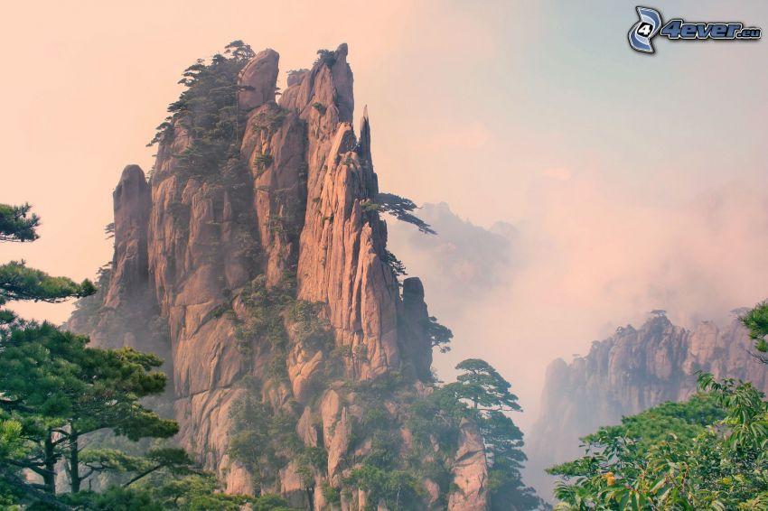 Huangshan, klippiga berg, moln