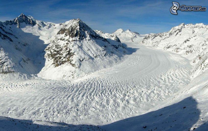 isdal, snöiga kullar