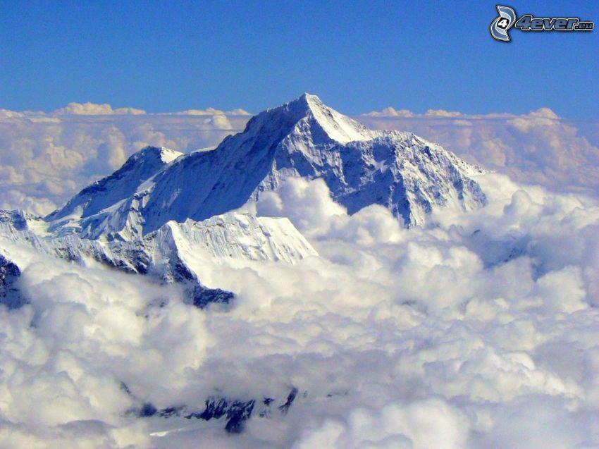 Mount Everest, ovanför molnen, snöigt berg